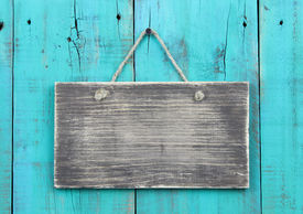 image of wooden fence  - Blank rustic sign hanging on weathered antique teal blue background - JPG