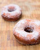 pic of sprinkling  - Sweet donuts sprinkled with sugar on wooden tray - JPG