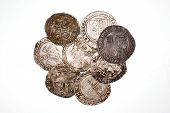 foto of shilling  - A lot of old silver coins with portraits of kings on a white background - JPG