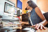 image of recording studio  - Portrait of an university student mixing audio in a studio of a radio - JPG