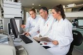 stock photo of scientist  - Team of scientists working together at the laboratory - JPG