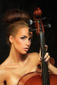 pic of cello  - Photo golden beautiful female musician playing a cello - JPG