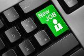 image of keyboard  - dark grey keyboard green button new job - JPG