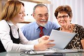 stock photo of business meetings  - Senior couple meeting with agent or advisor - JPG