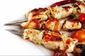 pic of kebab  - fresh roast chicken shish kebab on white platter - JPG