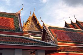 foto of apex  - gable apex on temple roof with blue sky background - JPG