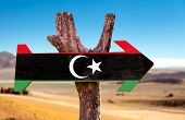 image of libya  - Libya Flag wooden sign with dry background - JPG