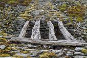 pic of gravity  - Only remaining wood bridge of gravity incline Cwm Penmachno Slate Quarry Snowdonia Wales United Kingdom - JPG