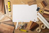 picture of baseboard  - DIY work table top view with blank project at center wood swatches mobile phone and work tools - JPG