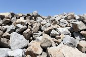 stock photo of cleaving  - stack of limestone mound for building - JPG