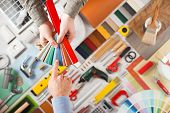 pic of hand tools  - Male hands holding swatches and choosing the right color work tools on background top view DIY and home renovation concept - JPG