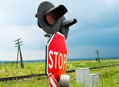 stock photo of traffic sign  - Traffic lights stops sign and crossbuck sign at the railroad crossing in Ukraine - JPG