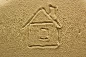 stock photo of mud-hut  - Abstract drawing of a house on sand - JPG