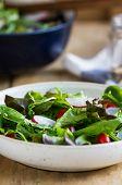 stock photo of salt-bowl  - Fresh leafy salad by big bowl of salad and sea salt  - JPG