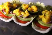 picture of tomato sandwich  - Raw vegan sandwiches on a cabbage leaf with avocado - JPG