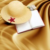 image of panama hat  - Straw hat with book and red starfish on shabby paper background - JPG