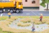stock photo of street-rod  - Miniature fishermen near a road close up - JPG