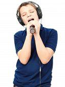 stock photo of singing  - Teenage boy in headphones - JPG