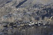 stock photo of mustang  - Local houses at Muktinath village in lower Mustang district Nepal. This photo was shot in early morning. Area was cover by snow. - JPG