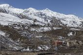 pic of mustang  - Local houses at Muktinath village in lower Mustang district Nepal. This photo was shot in early morning. Area was cover by snow. - JPG