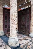 picture of carving  - Marble portal with pink carved columns and carved doors - JPG