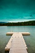 image of dock a lake  - Small dock under a turquoise sky on a lonely lake - JPG