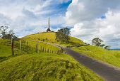 stock photo of maori  - Obelisk on the summit of the One Tree Hill reminds of signing the Treaty of Waitangi - JPG