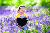 image of little young child children girl toddler  - Child playing in bluebells forest - JPG