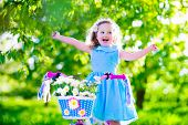 pic of little young child children girl toddler  - Happy child riding a bike - JPG
