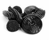 foto of licorice  - sweet licorice spiral isolated on white background