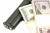 pic of gun shot wound  - banknotes and gun on white background closeup - JPG