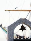 stock photo of mast  - mast sailing ship on the background of the bell - JPG