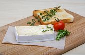 picture of brie cheese  - Soft brie cheese with rosemary thyme and toast bread - JPG