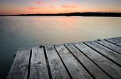 stock photo of pier a lake  - Small wooden pier on big lake at sunset in Ukraine - JPG