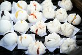 foto of steam  - Chinese dumplings being steamed on the traditional bamboo pan - JPG