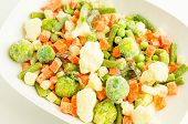 stock photo of frozen  - Frozen vegetables carrots peas broccoli green beans Brussels sprouts cauliflower - JPG