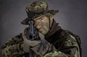 picture of m4  - Soldier in camouflage and modern weapon M4 on black background - JPG