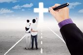 picture of holy family  - Back view of family standing on the road and guided to follow the cross - JPG