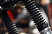 foto of suspension  - Close up shot of the front suspension of a motorcycle protected by rubber gaiters - JPG