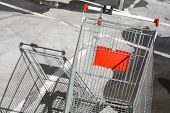 stock photo of trolley  - Color image of an abandoned shopping trolley in a parking lot - JPG
