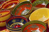 image of ceramic bowl  - Colorful ceramic bowls ready for sale on the market.(Arles France) ** Note: Shallow depth of field - JPG
