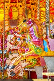 picture of merry-go-round  - old merry go round ride at a fair - JPG