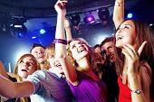 stock photo of night-club  - Image of pretty girls dancing with their boyfriends in night club - JPG