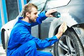 auto mechanic worker applying washing car body preparing for painting at automobile repair and renew poster