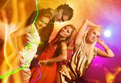 stock photo of night-club  - happy people dancing in the night club - JPG