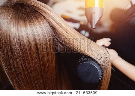 poster of Close-up of hair dryer for hair drying concept hair salon female stylist.