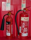stock photo of fire extinguishers  - an image of two fire extinguisers health and safety - JPG