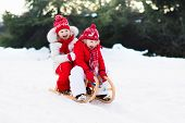 Kids On Sleigh. Children Sled. Winter Snow Fun. poster