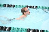 stock photo of swim meet  - Boy swimming breaststroke - JPG