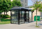 image of bus-shelter  - Bus shelter in urban setting on sunny day - JPG
